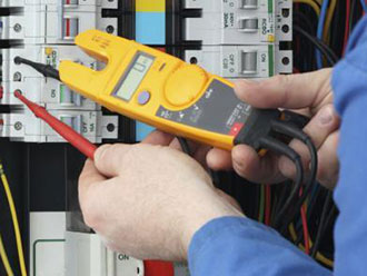 a Fusedup electrician testing a circuit breaker
